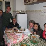 with guests and stuff/owners in the kitchen