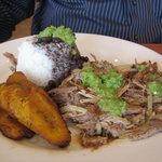 roast pork, rice, and plantains.  hot green sauce yum