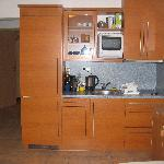 Kitchenette with huge refridgerator and new stove