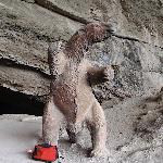 The statue of the milodon at the entrance to the cave.  My back pack is at his feet to give scal