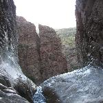 End of the trail; waterfall falling into desert.