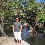 Josue' on the walkway/dock on the river