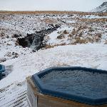 Geothermally heated hot tubs next to the stream