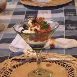 Start breakfast with fruit parfait with moscarpone