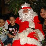 My wife and boys with 'Papa Noel'