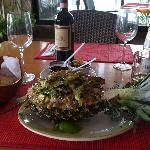 Tilapia over brown rice and vegetables served in a pineapple = $10.00 usd !! AMAZING !