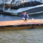 One of kids jumping into the lake