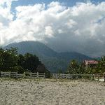 A view from the beach, looking towards the mountains.  The inn is located in the right of photo.