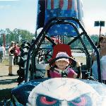 """A kid sitting in """"Bada Bing"""" a swamp Buggy that was getting ready to race"""