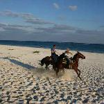 My husband is galloping on the beach together with on of the tourguides.