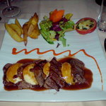 Steak with cheese and a hazelnut sauce
