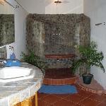The georgous bathroom with a rain shower