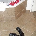 His shoes next to the jacuzzi