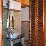 Bathroom (huge bathtub obscured by door)