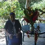 Ma sitting next to one of her beautiful floral arrangements