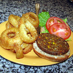 a veggie burger with onion rings