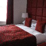 Bedroom One, red plush and comfortable!