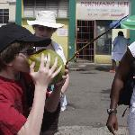 Showing us how to takle a coconut