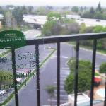 View out of our window, highway, pool and the 'permanently closed' sticker on the door.