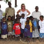 WIth the orphaned children and headteacher