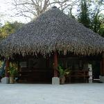 Right next to the pool, the tiki hut where breakfast is served every morning.