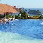Pool with swimup bar overlooking ocean