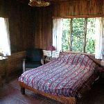 Room with one double bed and twin