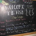 specials board as entering tin fish from hotel lobbhy