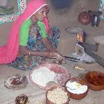 Chokhi Dhani Village - woman making roti over a fire