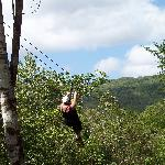 A person zip-lining in our group