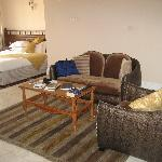 My room - with lived-in look.  Large bed, sitting area and fridge on two leves.  Not shown are d
