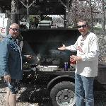Roger and Dean roasting the pig