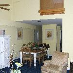 Other end of the living room, heading to the door, kitchen guest bedroom and bath