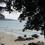view from small cafe on rock at end of Patong Beach