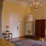 Bedroom door, old tile stove in corner