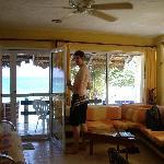 Living room and balcony overlooking beach.