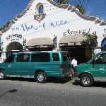 Front of hotel with two standard Cabo taxi vans