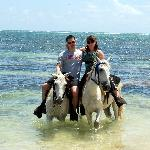 Wading with our horses in the Caribbean