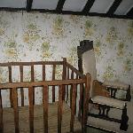 childs cot in middle family room