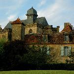 The priory rests in the shadow of chateau de biron