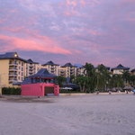 View of hotel from beach at sunset