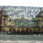 From the rear reflected in the building opposite