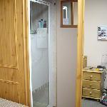 Toilet is behind the mirror sliding door