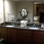 Double sink with vanity mirror and chair
