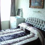 a vey nice bedroom with elegant covers
