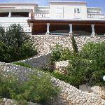 steps from the resturant terrace to private beach