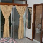 Patio doors to balcony with view of Road Bay