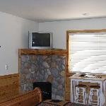 electric stove/fireplace and table