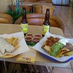 Rudy's carne asada burrito, nachos with beef, salsa & hot sauce