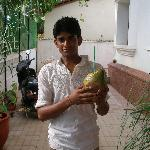 Staff offering fresh coconut juice